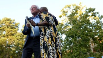 Sen. Bernie Sanders (I-Vt.) and his campaign chief Nina Turner, now a candidate for Ohio's vacant 11th congressional district, hug on stage during a campaign rally in Sept. 2019 (Sara D. Davis/Getty Images)