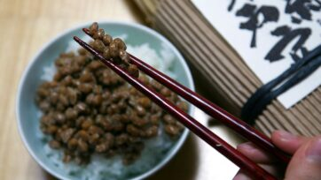 A person dines on a dish of natto; a traditional Japanese dish made from steamed and fermented soybeans, served with white rice in Mito, Japan. (Koichi Kamoshida/Getty Images)