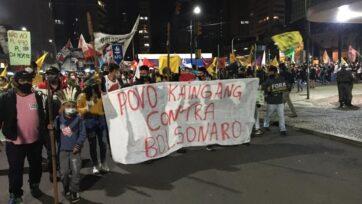 Indigenous people join the protestors against President Bolsonaro in Porto Alegre. (Luciano Nagel/Zenger)