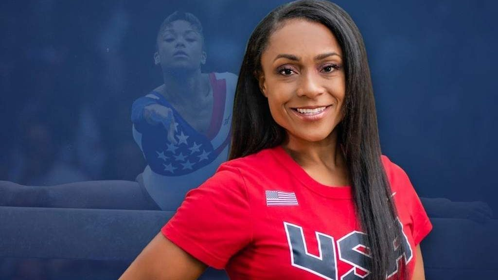 <p>Former Olympic standout Dominique Dawes, now a mother of four, is focused on creating a healthy environment for children at her Maryland gymnastics facility. (Courtesy of Dominique Dawes)</p>