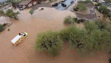 Two people were stranded by floods on top of the truck in Arizona in the United States on the 23rd of July 2021. Note: The picture is a screenshot from the video (@MCSOaz/Zenger News)