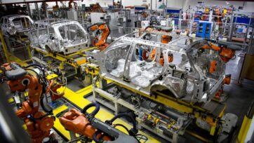 Robotic systems work on the chassis of a car during an automated stage of production at the Jaguar Land Rover factory in Solihull, England. (Leon Neal/Getty Images)