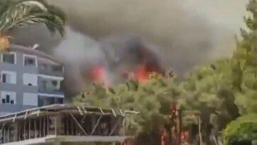 Thick, black smoke from a forest fire that officials believe was intentionally set spreads through the city of Antalya, Turkey. (@bursayadairherbirsey/Zenger)