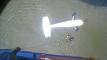 The crew of a U.S. Coast Guard helicopter hoists the pilot from a single-engine plane that crashed in Fourleague Bay near Morgan City, Louisiana. (U.S. Coast Guard District 8, DVIDS/Zenger)