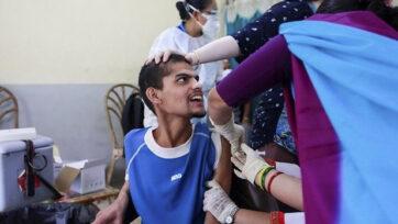 People receive Johnson & Johnson vaccine against the coronavirus disease (COVID-19) at Nepal Disabled Association Khagendra New Life Centre in Kathmandu