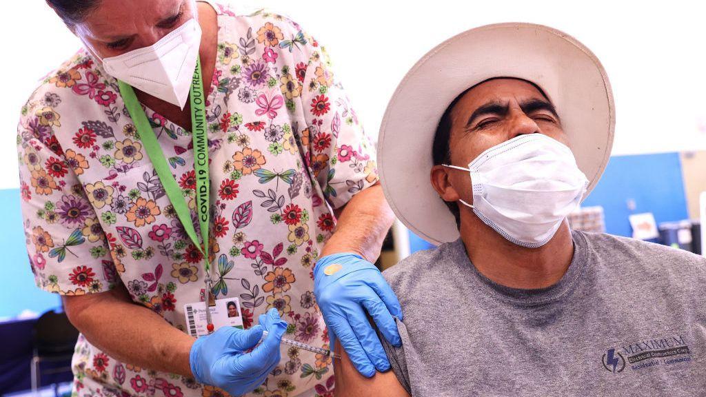 As Mask Mandates Return, Health Experts Bemoan Slowing Vaccine Rates
