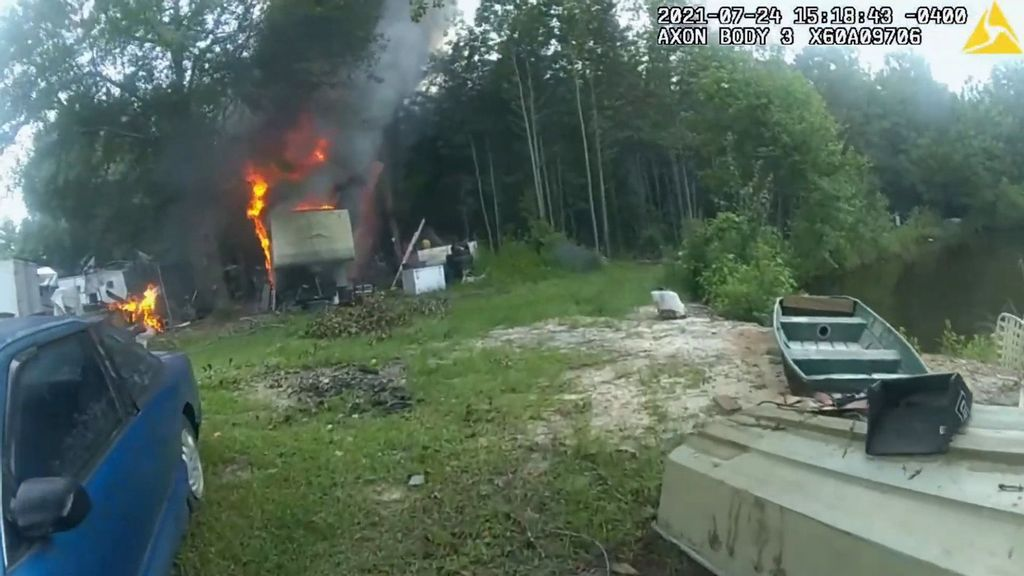 VIDEO: Cops Risk Lives To Save 2 Trapped Dogs Near Burning Trailer