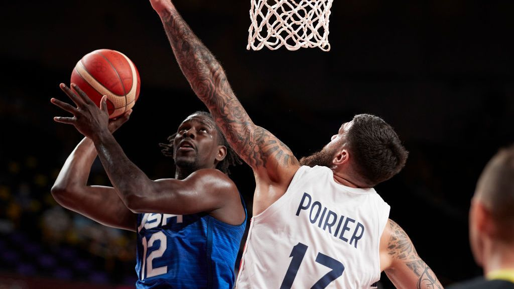 <p>Jrue Holiday of USA and Vincent Poirier of France battle for the ball on day two in the Men's First Round Group A match between France and USA at the Tokyo 2020 Olympic Games at Saitama Super Arena on July 25, 2021 in Saitama, Japan. (Photo by Berengui/DeFodi Images via Getty Images)</p>