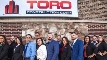 Luis Vázquez, his wife Socorro, his brother Carlos and the rest of Toro Construction Corp. (Courtesy of Toro Construction Corp.)