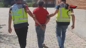 Fugitive Domenico Paviglianiti, center, is taken back into custody by authorities in Spain. The mafia don was mistakenly released from an Italian prison in 2019. (Zenger News)