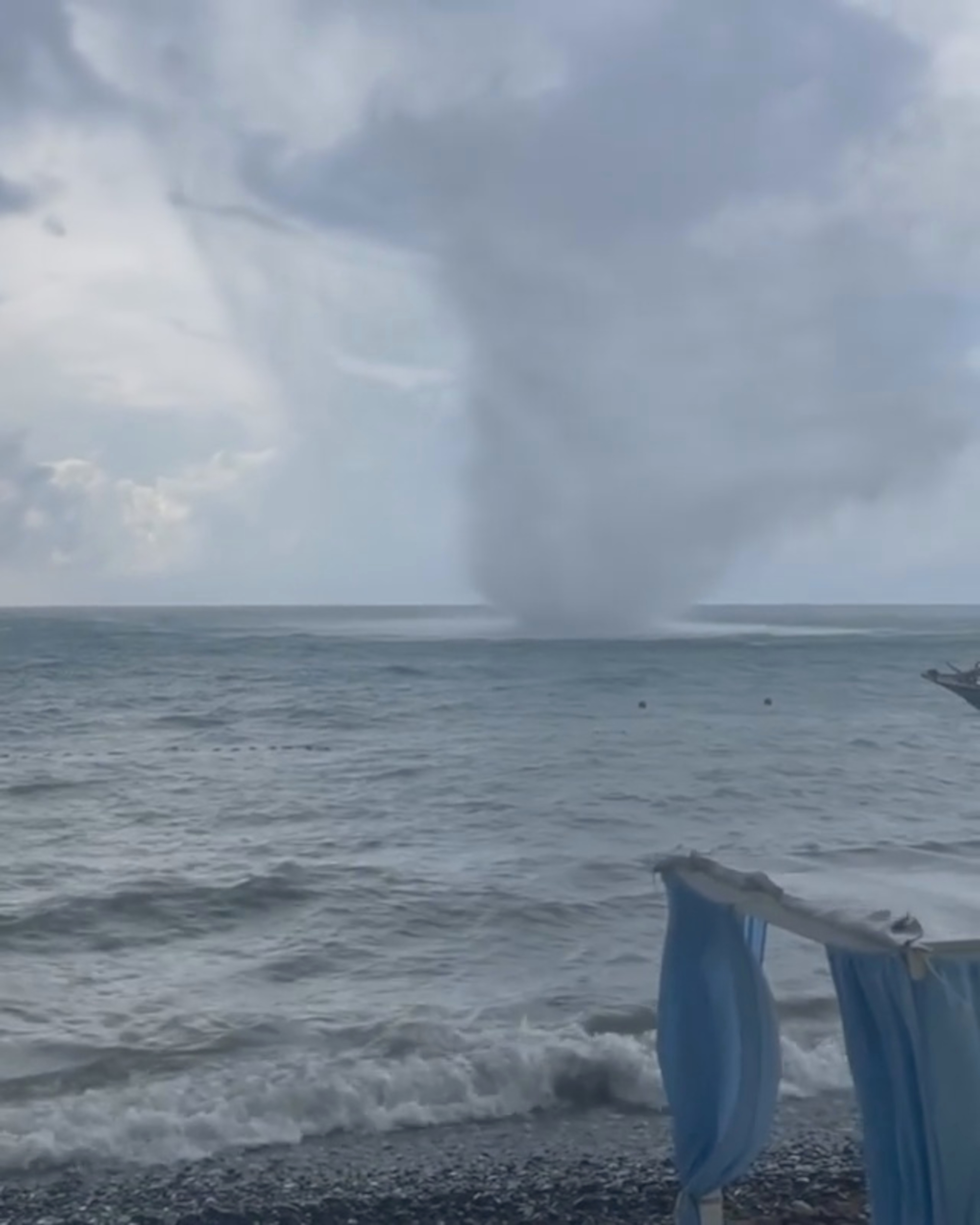 VIDEO: Spout Of Luck: Huge Sea Tornado Rips Through Beachside Cafe