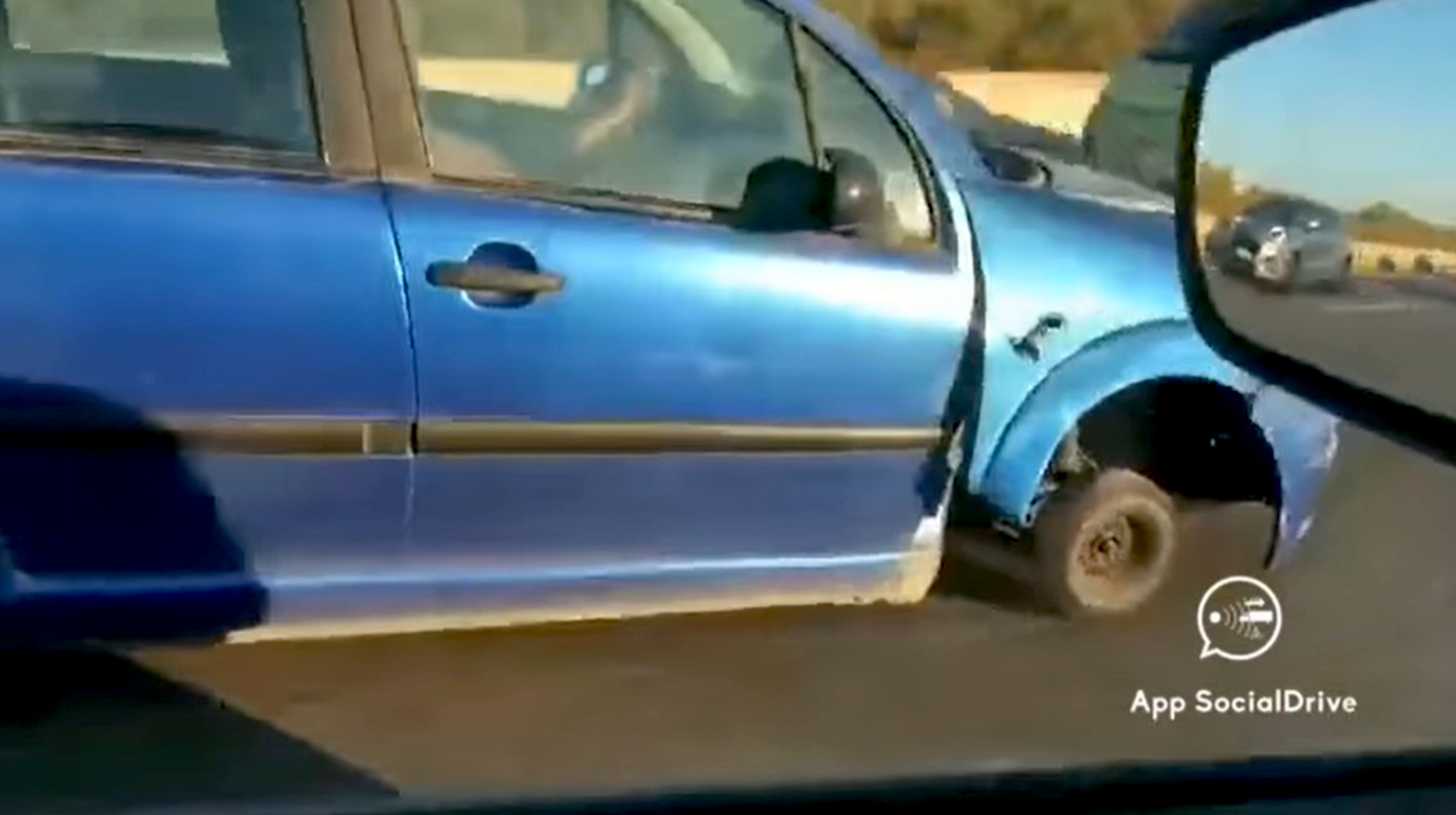 VIDEO: A Wheel Mystery: Middle-Lane Road Hog Motors Along Busy Highway With Missing Tire