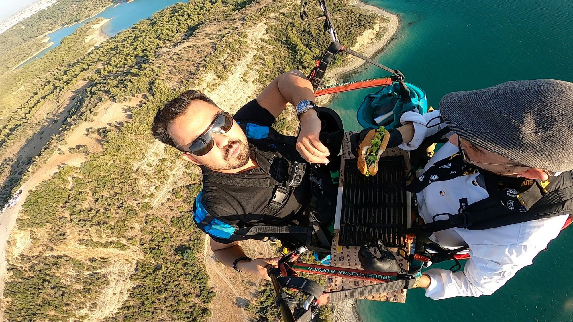 VIDEO: You Want Flies With That? Paragliding Chef Cooks Cheeseburger At 2,000ft