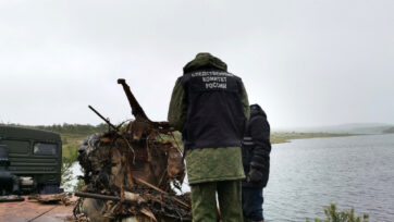 Russian investigators raised a World War II biplane with the remains of its pilot still in the cockpit from an unnamed lake in an Arctic region in July. (IC of Russia in the Murmansk region/Zenger)