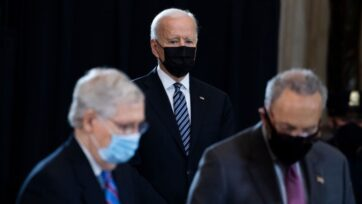 The administration of President Joe Biden (center), will face several legislative challenges in September in which will also involve Minority Leader Mitch McConnell (R-KY), right, and Senate Majority Leader Chuck Schumer (D-NY). The three are shown here paying their respects to slain U.S. Capitol Police Officer William Evans in Washington D.C. on April 13. (Tom Williams-Pool/Getty Images)