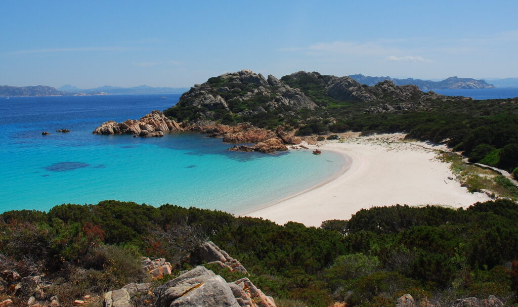 """Spaggia Rosa, the """"Pink Beach,"""" is a protected beach with pinkish white sand made from crushed corals, in Isola di Budelli, Sardinia, Italy. (Luca Giudicatti/Flickr)"""