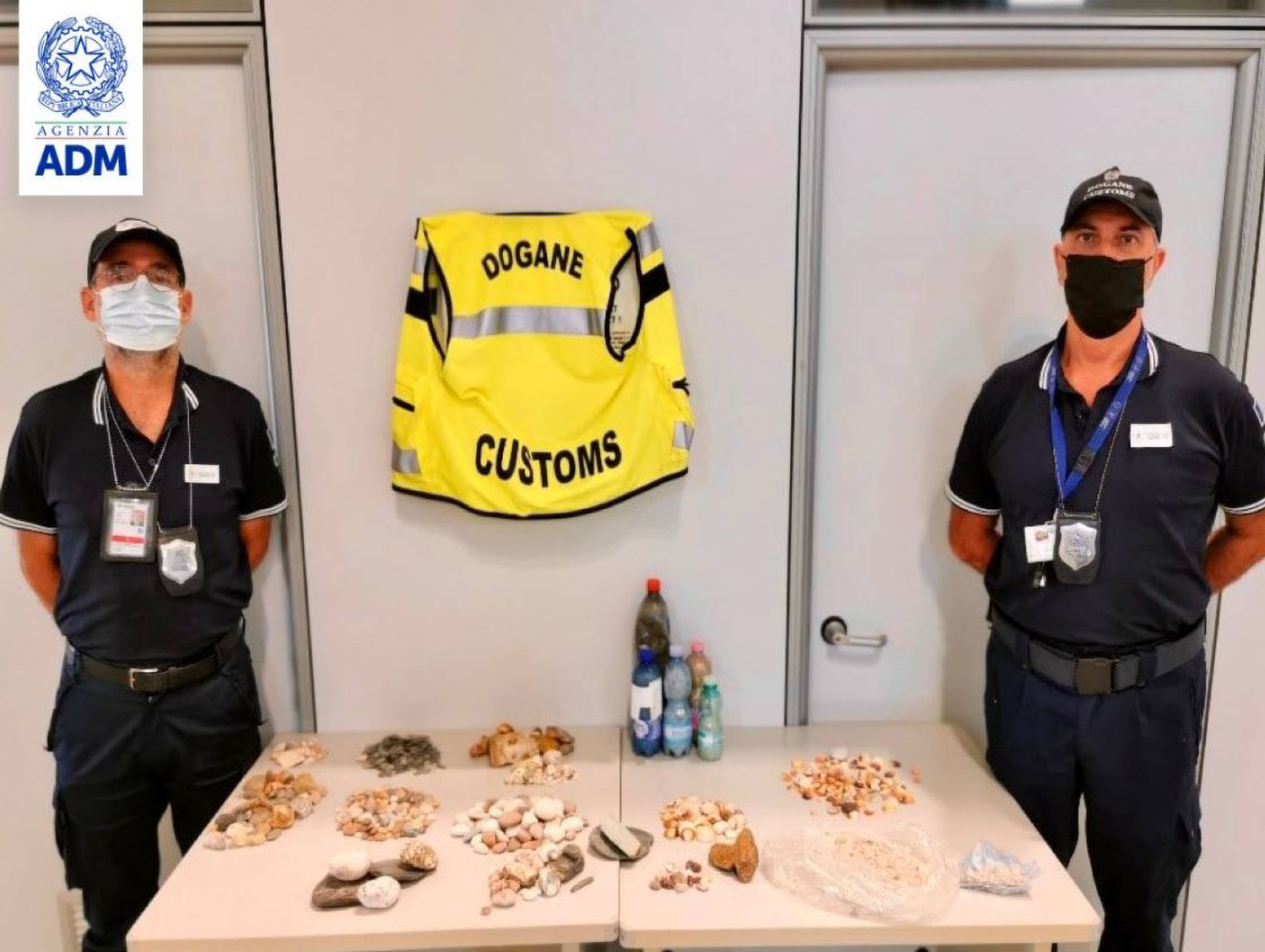 <p>Customs officers confiscated seized, in total, 9,038 pounds of sand in plastic bottles, 476 sea pebbles and 256 shells from passengers' luggage as they were leaving the Italian island of Sardinia from Alghero Airport on Aug. 27. (ADM/Zenger)</p>