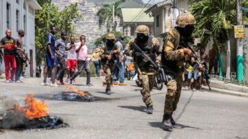 Haitians protest near the police station in Petion Ville a day after President Jovenel Moïse's assassination on July 7 in Port-au-Prince. Haiti remains in turmoil as new authorities are still to be defined and assassins identified. (Richard Pierrin/Getty Images)