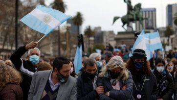 """Argentines demonstrate in Buenos Aires on Aug. 16. In the so-called """"March of the Stones,"""" they remembered the more than 110,000 COVID-19 deaths in the country at the time, with a stone as a symbol of each victim. In the Sept. 12 primaries, they will be able to express their discontent or support for the government and its handling of the pandemic and other issues. (Tomas Cuesta/Getty Images)"""