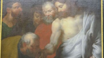 """The painting """"Thomas Kissing the Hand of Christ"""" in Saint Peter and Paul Church, in Pulle, Belgium, was painted over to put Peter in the painting. The discovery was made during a restoration. (Obeeliks bvba/Zenger)"""