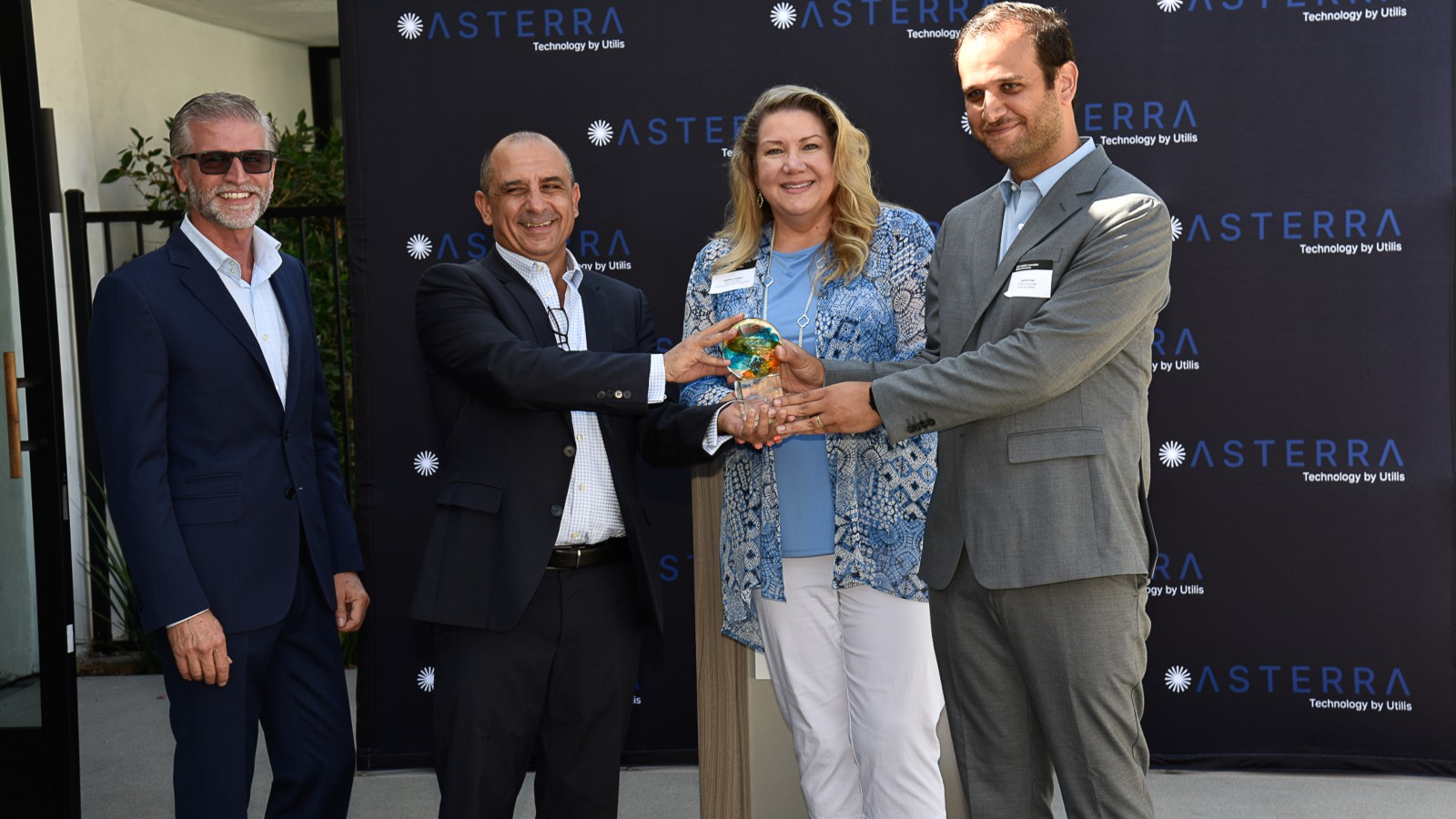 <p>From left, Asterra VP-business development James Perry; Asterra CEO Elly Perets; AWWA VP Heather Collins; and Utilis/Asterra CTO and co-founder Lauren Guy. (Asterra)</p>