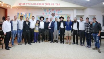 Students at a secular high school with ultra-Orthodox Jewish visitors from the unity project of Be a Mensch Foundation. The foundation is working to give secular high school and post-high school students a rare chance to get acquainted with ultra-Orthodox citizens. (Courtesy of Be a Mensch Foundation)