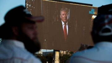 Former U.S. President Donald J. Trump appears on screen during a Let Us Worship prayer service on the National Mall in Washington, D.C. for the 20th anniversary of the 9/11 attacks on Sept. 11, 2021. (Anna Moneymaker/Getty Images)