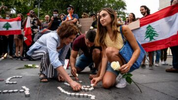 Lebanese Americans attend a memorial for victims of the explosion in 2020 at the Port of Beirut in New York City's Washington Square Park on Aug. 4. (Luigi W. Morris)