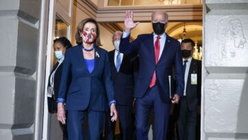 House Speaker Nancy P. Pelosi (D-Calif.) arrives with U.S. President Joseph R. Biden Jr. to meet with House Democrats at the Capitol Building in Washington, D.C., on Oct. 1. Biden called the session to try to overcome an impasse over his spending plans. (Kevin Dietsch/Getty Images)