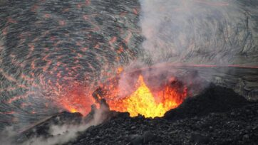 Fountaining from the western vent in Halemaʻumaʻu's crater, at the summit of Kīlauea. Spatter from the fountain continues to build up a horseshoe-shaped cone around the vent, with lava flowing into the lake at its base on Hawaii's Big Island on Oct. 5. (USGS N. Deligne/Zenger)