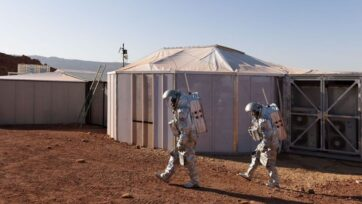 The astronauts walk past their intended habitat in the Israeli desert, in a simulation of being on Mars. (Florian Voggeneder/OeWF)