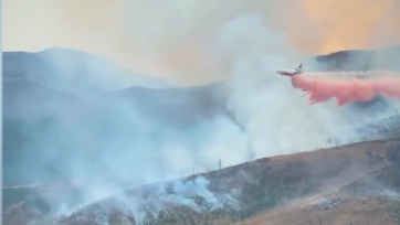 A tanker jet drops a fire-retardant chemical on the Crown Mountain Fire in Montana's Helena-Lewis and Clark National Forest. (Helena-Lewis and Clark National Forest/Zenger)