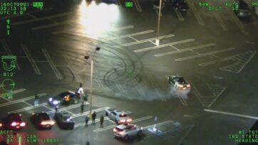 """A driver is seen performing """"doughnuts"""" in the parking lot of an Atlanta shopping center shortly before police arrive on the scene. (Atlanta Police Department/Zenger)"""