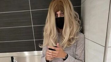 Photo purportedly showing Jacob M. Guerrero posing as a woman and wearing a wig, in a women's bathroom at the Wrentham Outlet in Wrentham, Massachusetts. (Wrentham Police Department/Zenger)