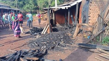 Villagers walk by the damage from an arson attack on a pastor's home that doubled as a worship space for local Christians in Kandhamal, Odisha, East India. (Courtesy Birendra Singh)