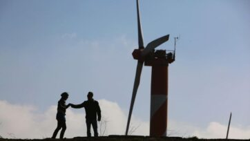 An Israeli couple visits the wind farm on Mount Bnei Rasan overlooking the border with Syria on Nov. 27, 2009, in the Golan Heights. The 10 wind turbines produce 6 megawatts of electricity which is used by local industry and the residents of the disputed plateau that Israel captured from Syria in the 1967 Six Day War. (David Silverman/Getty Images)